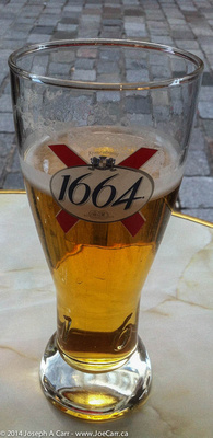 A glass of 1664 French beer