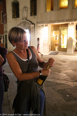 Jennifer opening Prosecco to serve us before our Gondola ride