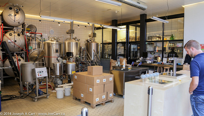 Tasting counter and fermentation tanks in brewery