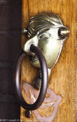 Ornate brass door knocker