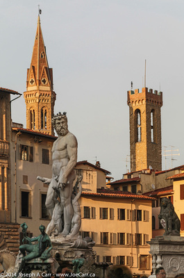 Poseidon statue with towers behind