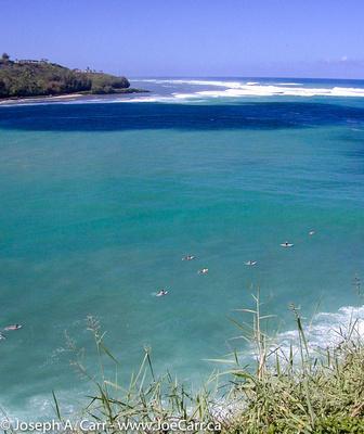 Surfers at Kalihiwai Bay