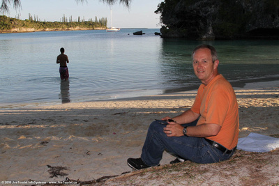 Joe sitting on the shore in Baie de Kanamera