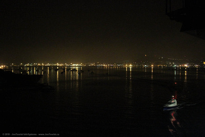 Pilot boat escorts Volendam through Noumea harbour during night departure