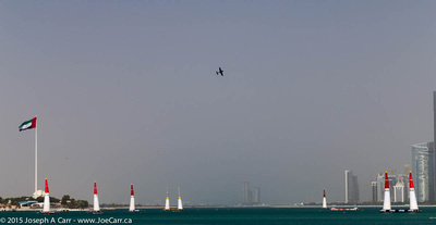 Aerobatic aircraft doing a circuit between pylons in the harbour