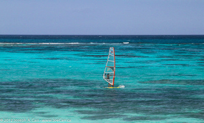 Wind surfer in the coral lagoon