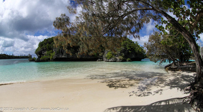 Kanamera Bay white sand beach and small island