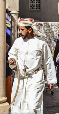 A man wearing a khanjar, a ceremonial sword