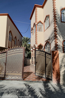 Ornate gates, courtyard and house