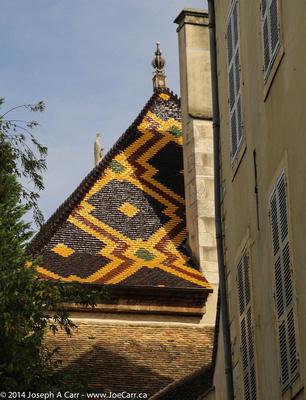Burgundy coloured tile roof