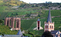 Werner Kapelle ruins, observation tower and the local church tower with wine fields climbing up the hills behind the town