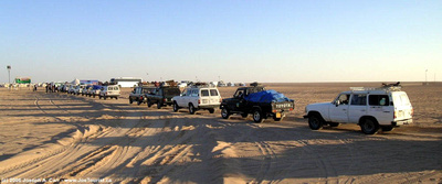 A parade of SUV's leaving the Eclipse Camp