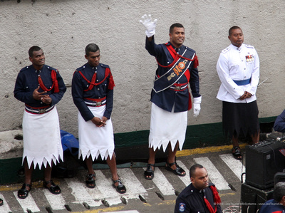Fiji Police Band - bandleader waving goodbye