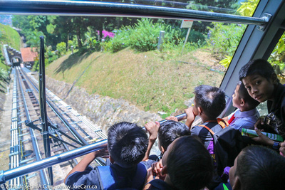 Boys watching the funicular train proceed downhill