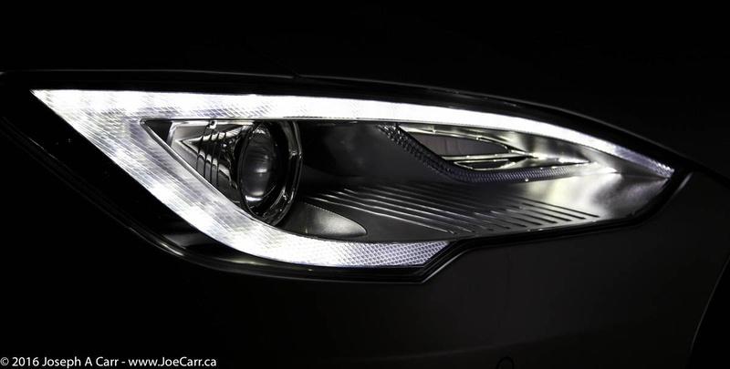 Right front headlight Tesla running lights at night