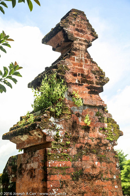 Plant-covered brick column