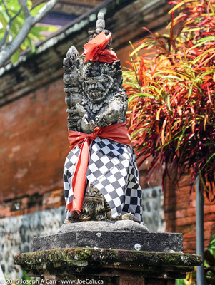 Monkey statue guarding the corner of the temple