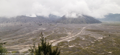 Cloud-shrouded Mount Bromo and the Sea of Sand