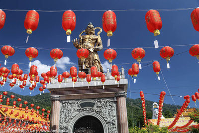 Golden statue with hundreds of Chinese lanterns