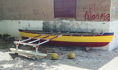 Outrigger canoe and two coconuts