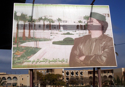 Giant Mu'ammar Gaddafi sign, Garyounis Resort behind