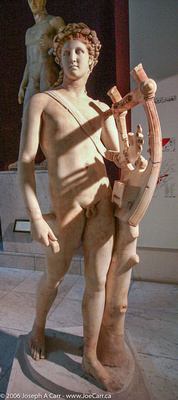 Marble statue of a boy with a lyre