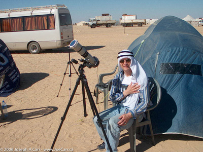 Joe with his eclipse photography setup wearing a ghutra