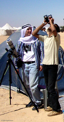 Joe lends his filtered binoculars to a Libyan to observe the Sun