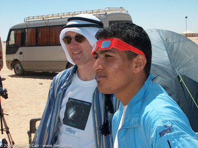 Joe and a young Libyan man share the experience on eclipse day