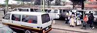 Taxi vans picking up passengers in a  Durban traffic jam