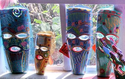 Folk art masks in the window