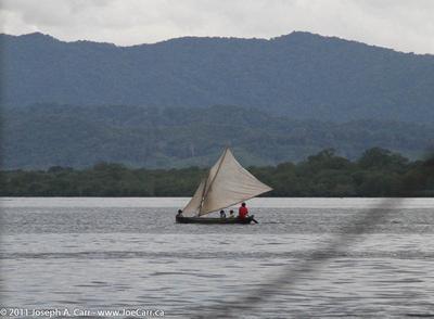 A Cuna sailing canoe