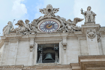 Bell and ornate clock tower on the front of the Basillica