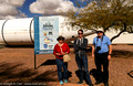 Diane Bell, Matt Watson and Reg Dunkley in front of the Space Shuttle booster and Pima Air Museum sign