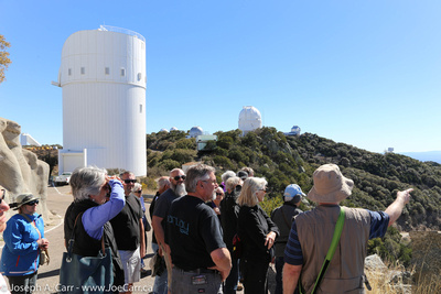 Our tour group with the Steward 2.3 metre observatory behind