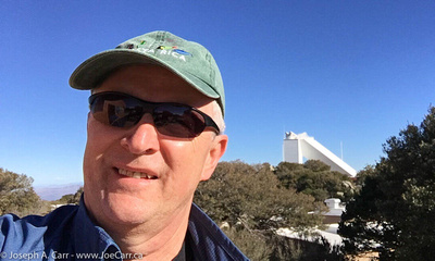 Joe on Kitt Peak with the McMath-Pierce Solar telescope behind