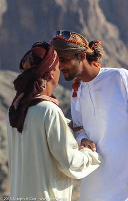 Two Omani men greeting each other in the Bedouin way by touching noses