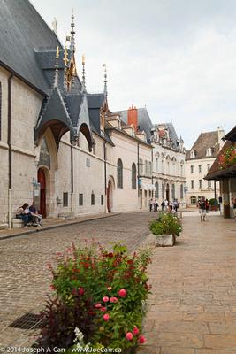 Hôtel-Dieu de Beaune on a cobblestone street