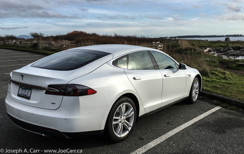 My Tesla Model S by the shoreline at Cattle Point