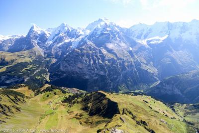 Eiger, Mönch and Jungfrau peaks with Mürren below
