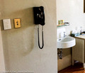 In-room sink, push button light switch, wall phone