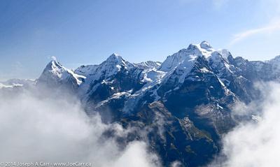 Eiger, Mönch and Jungfrau peaks in the clouds
