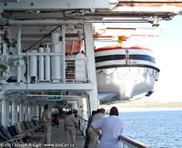 Tenders being hoisted aboard