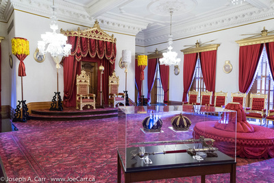 Crowns and settee and thrones in the throne room
