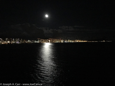 Honolulu and Waikiki shoreline lights with the Moon