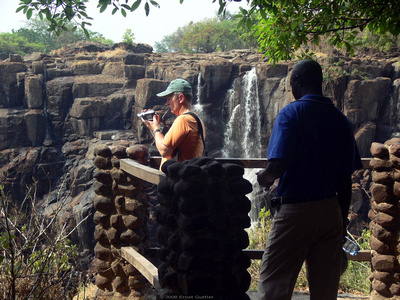 Joe taking video of Victoria Falls while Jacob looks on