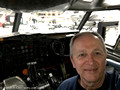 Joe inside a Boeing 720B cockpit simulator