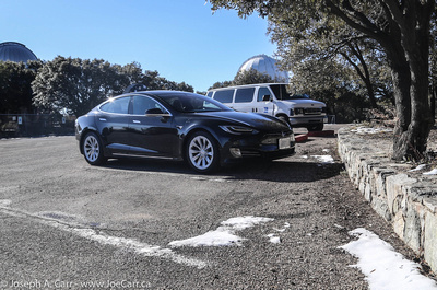 Tesla Model S in the parking lot with some snow