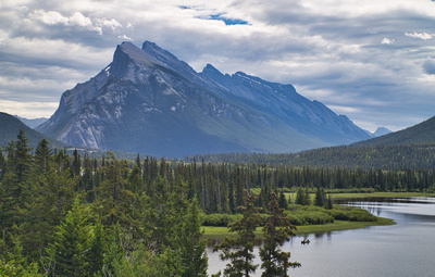Mt. Rundle and  canoeists on Vermilion Lakes