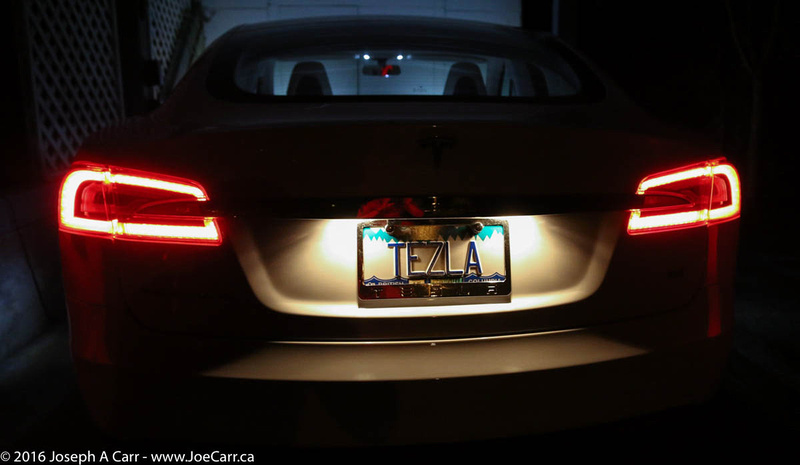 Rear Tesla running lights & personalize TEZLA license plate at night